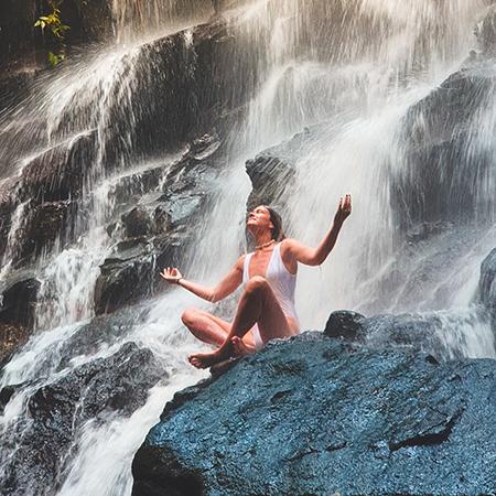 woman near waterfall - mindfulness
